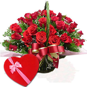(65) 2 dozen red roses in a basket W/ Chocolates