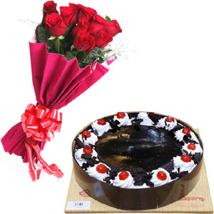 (27) Cooper's- 2.2 pound black forest cake W/ 12 pieces red roses in bouquet